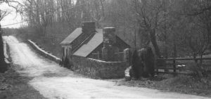 On the south side of Route 7, the Broad Run Tollhouse, seen in a photo from 1953, was a favorite place for selling moonshine as drivers had to stop there to pay tolls until 1924. Photo Credit: Muriel Spetzman
