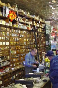 The walls are lined with storage drawers in Nicholes Hardware Store Purcellville VA